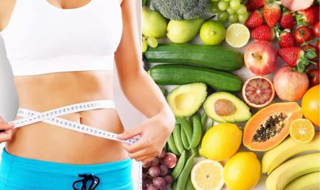 Woman measuring her waist against a backdrop of healthy foods.