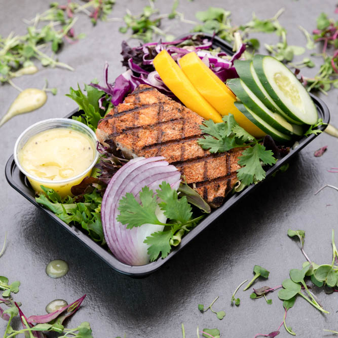 Seared Tuna Steak.  Served on a Bed of Organic Spring Greens with Sliced Cucumber, Yellow Peppers & Red Onions.  Sided with Our Champagne Vinaigrette Dressing